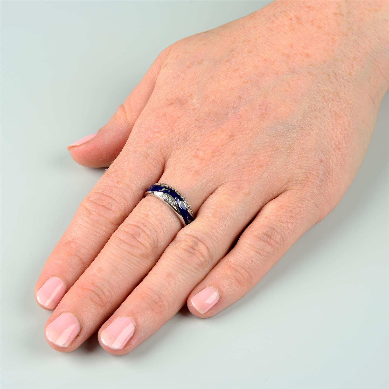 A limited edition 18ct gold diamond and blue enamel ring, by Fabergé. - Image 6 of 6