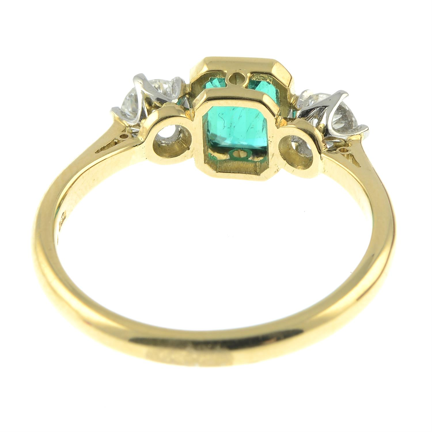 A platinum and 18ct gold emerald and brilliant-cut diamond three-stone ring. - Image 4 of 6