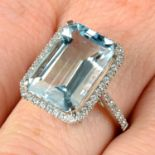 An 18ct gold aquamarine and brilliant-cut diamond ring.