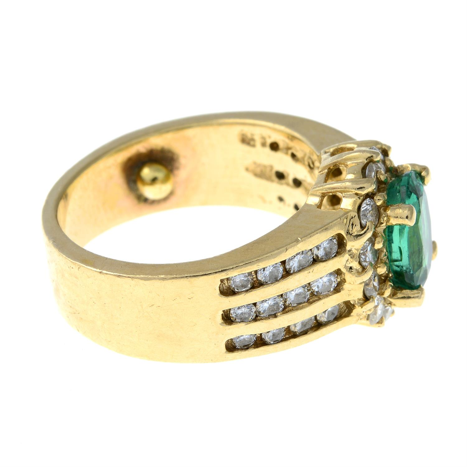 A Zambian emerald and brilliant-cut diamond cluster ring. - Image 4 of 7