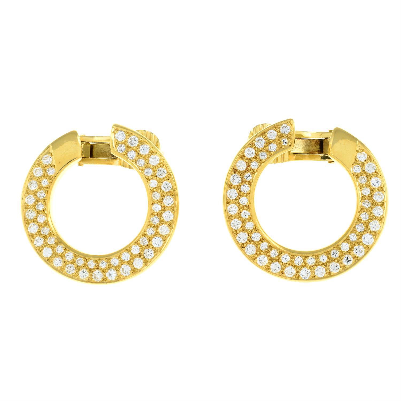 A pair of pavé-set diamond circular earrings. - Image 2 of 3