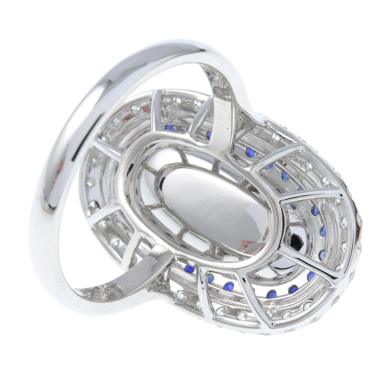 A moonstone, sapphire and diamond ring. - Image 5 of 6