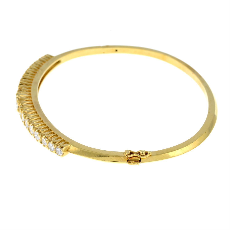 A graduated brilliant-cut diamond hinged bangle. - Image 4 of 4
