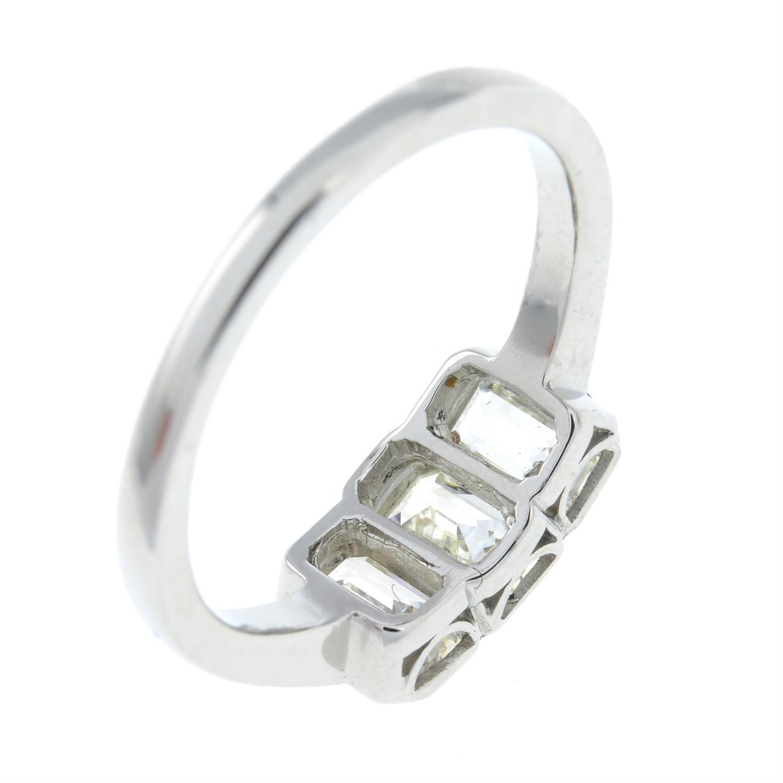A rectangular-shape diamond three-stone ring. - Image 5 of 6