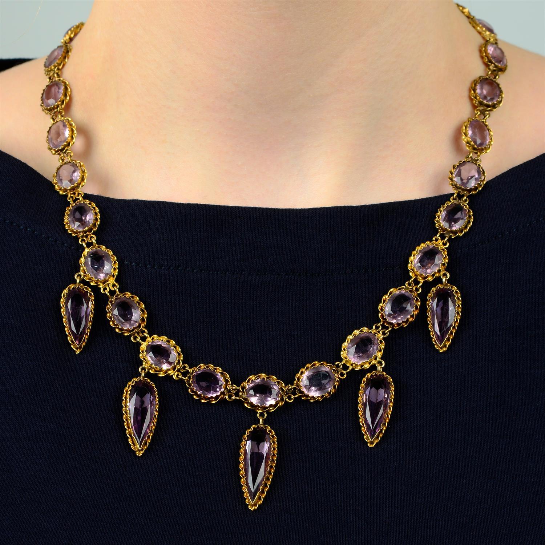 A 19th century gold purple paste fringe necklace.