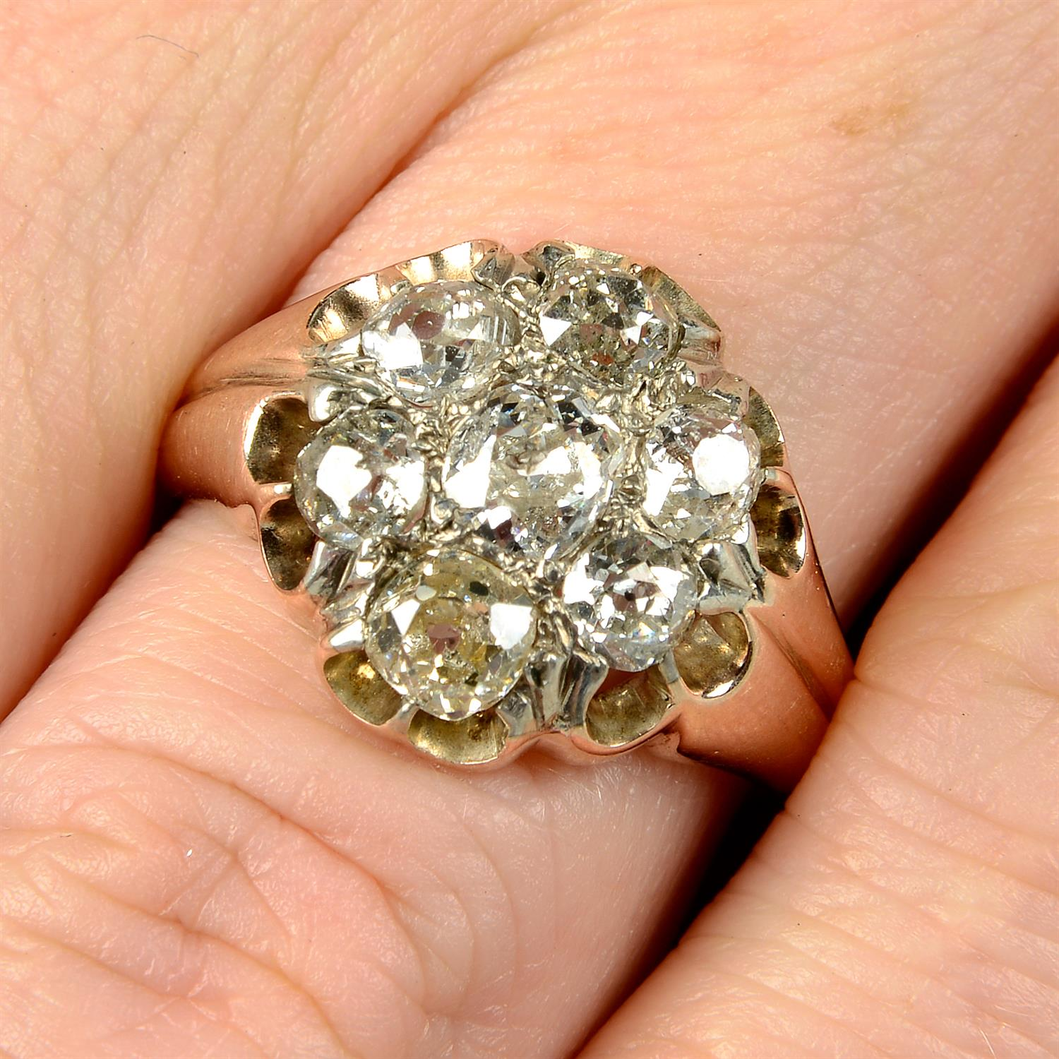 An early 20th century 9ct gold old-cut diamond cluster ring.
