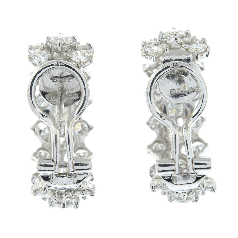A pair of 18ct gold diamond half hoop earrings. - Image 4 of 4
