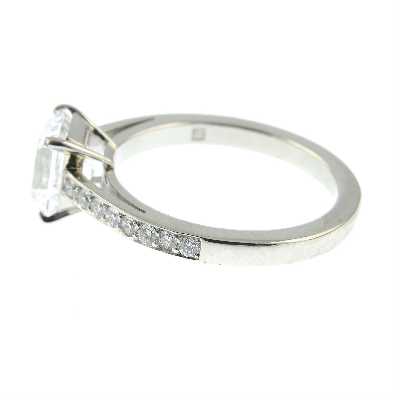 A platinum rectangular-shape diamond single-stone ring, with brilliant-cut diamond line shoulders. - Image 3 of 8