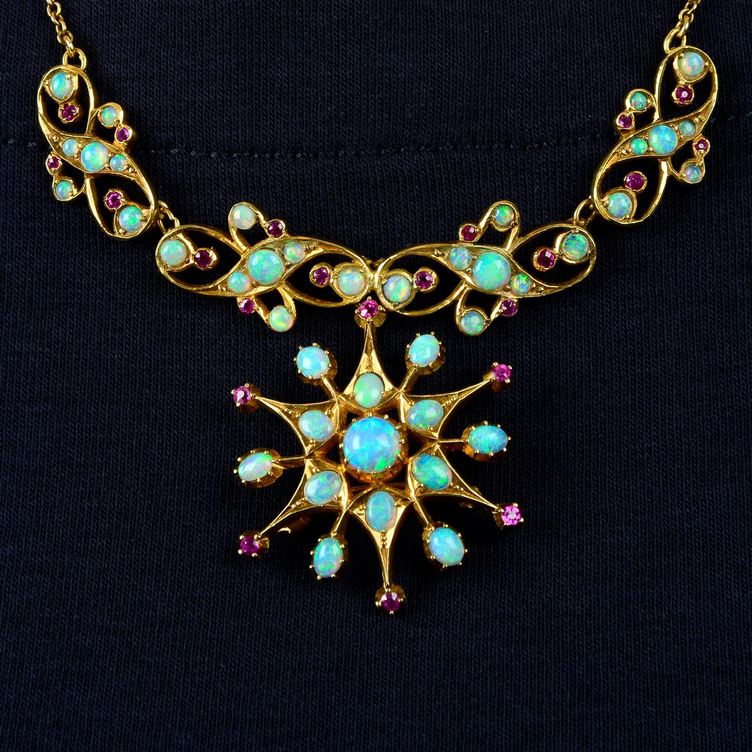 An early 20th century 15ct gold opal and ruby necklace.
