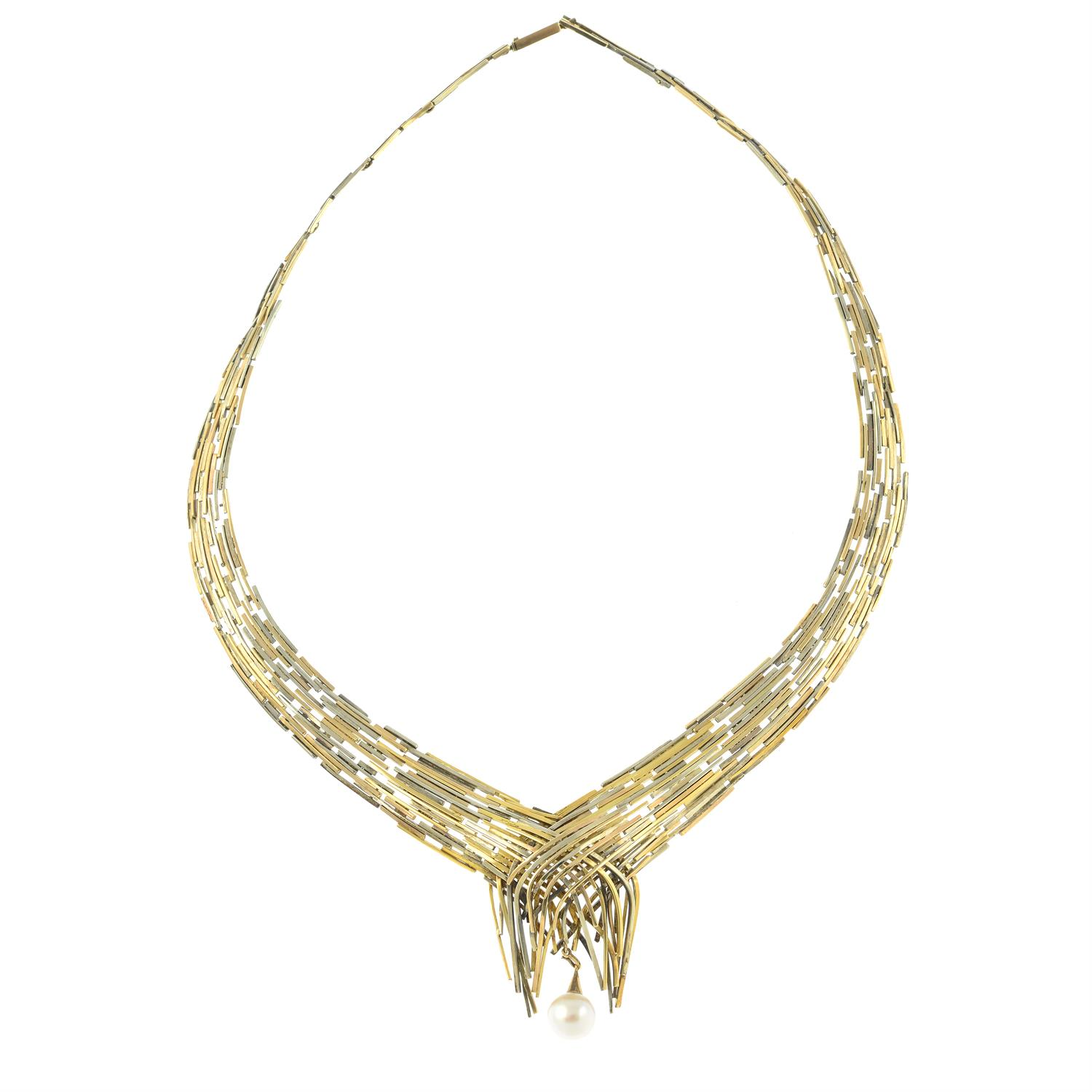 A 1960s tri-colour 9ct gold 'Boyd' articulated collar necklace, with interchangeable green - Image 3 of 7