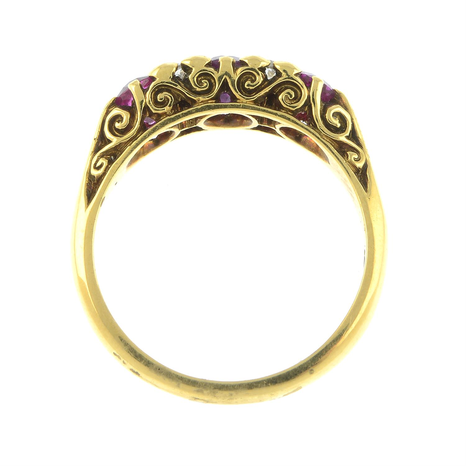 An 18ct gold slightly graduated ruby three-stone ring, with diamond double spacers and scrolling - Image 5 of 6