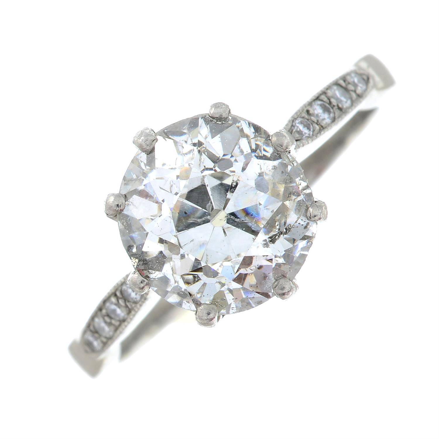 A platinum old-cut diamond single-stone ring, with brilliant-cut diamond line shoulders. - Image 2 of 6