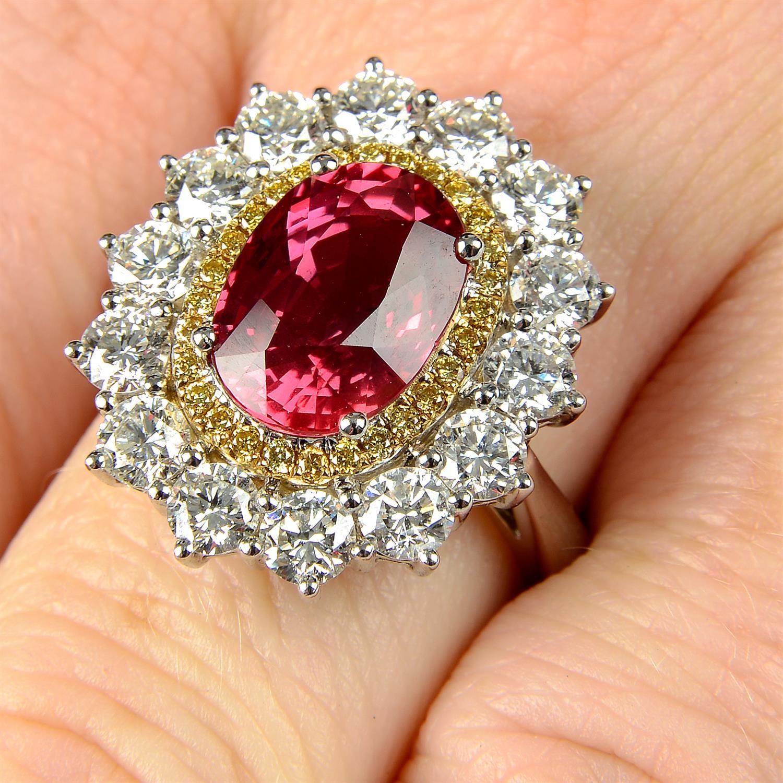 An 18ct gold orange sapphire, 'yellow' diamond and brilliant-cut diamond ring.