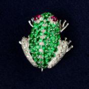 A tsavorite garnet and rose-cut diamond frog brooch, with ruby cabochon eyes.