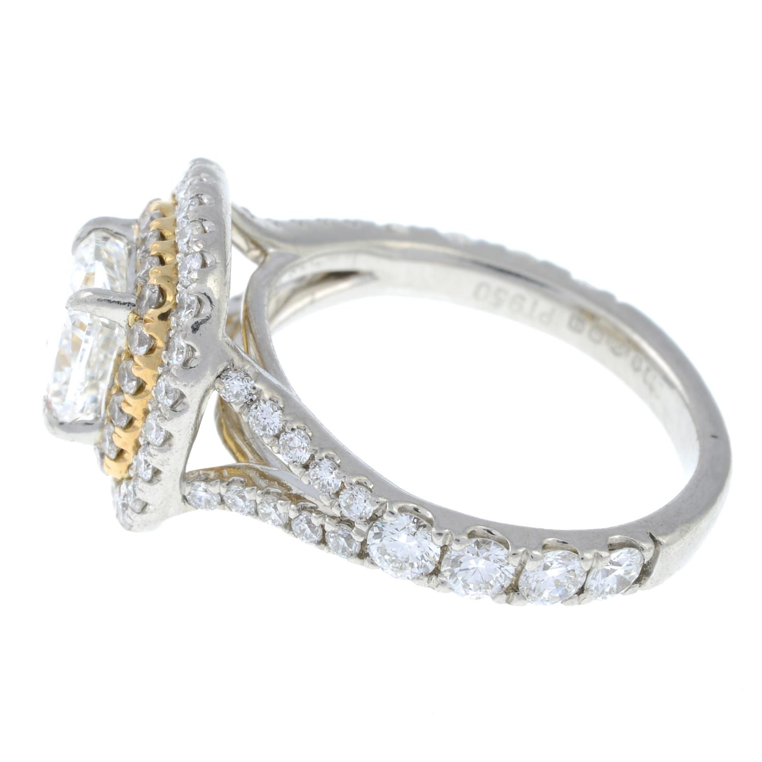 A platinum cushion-shape diamond ring, with brilliant-cut diamond surrounds and shoulders. - Image 3 of 7