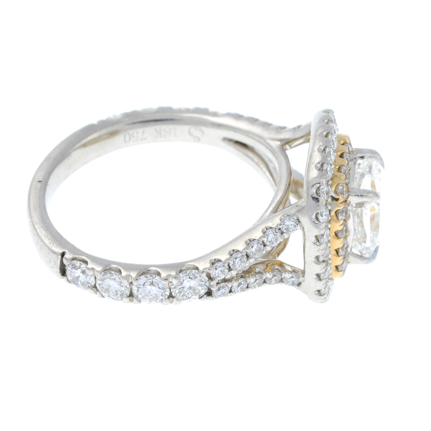 A platinum cushion-shape diamond ring, with brilliant-cut diamond surrounds and shoulders. - Image 4 of 7
