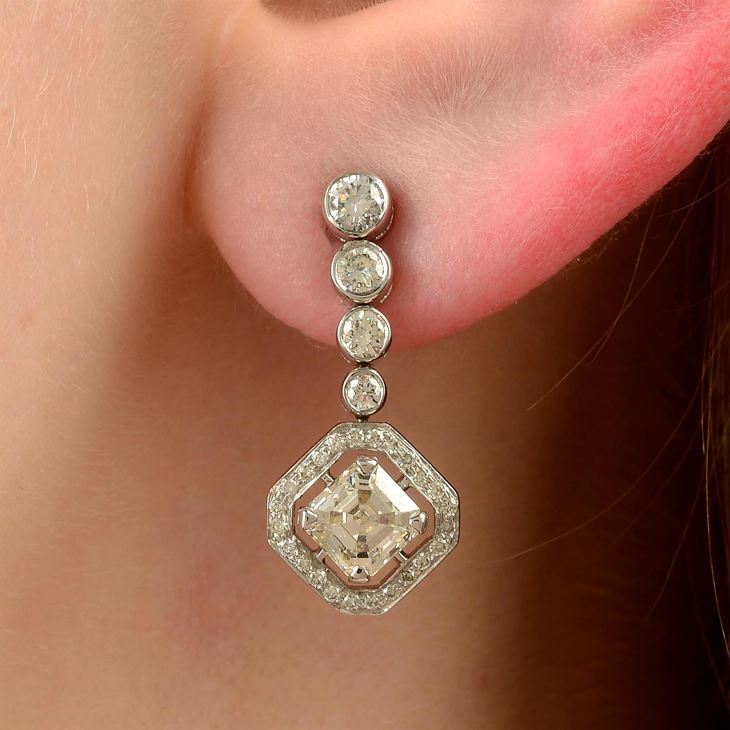 A pair of 18ct gold square-shape and brilliant-cut diamond earrings.