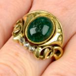 An early 20th century 18ct gold Egyptian Revival emerald cabochon and rose-cut diamond ring.