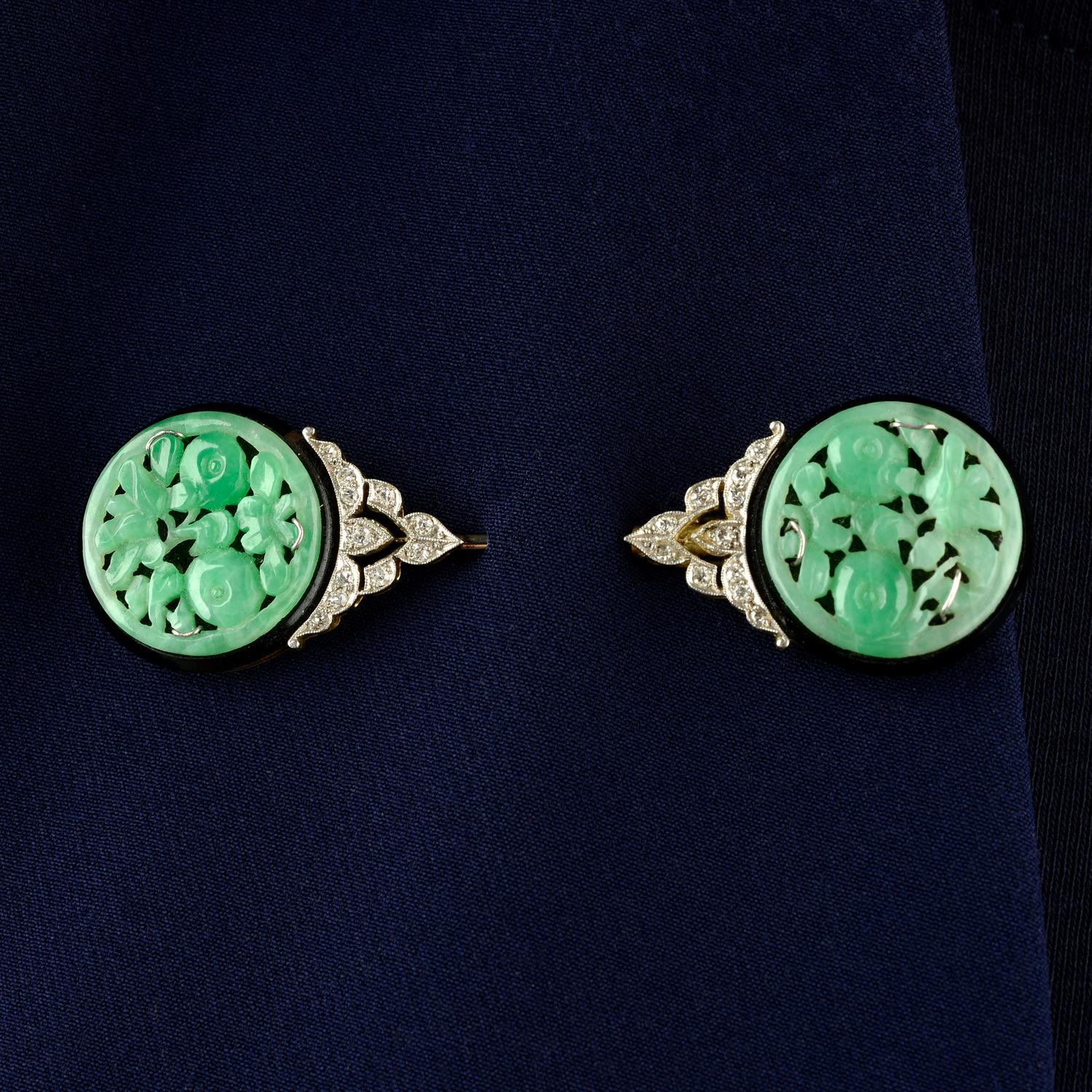 An Art Deco platinum and 15ct gold, carved jade, onyx and single-cut diamond jabot pin.