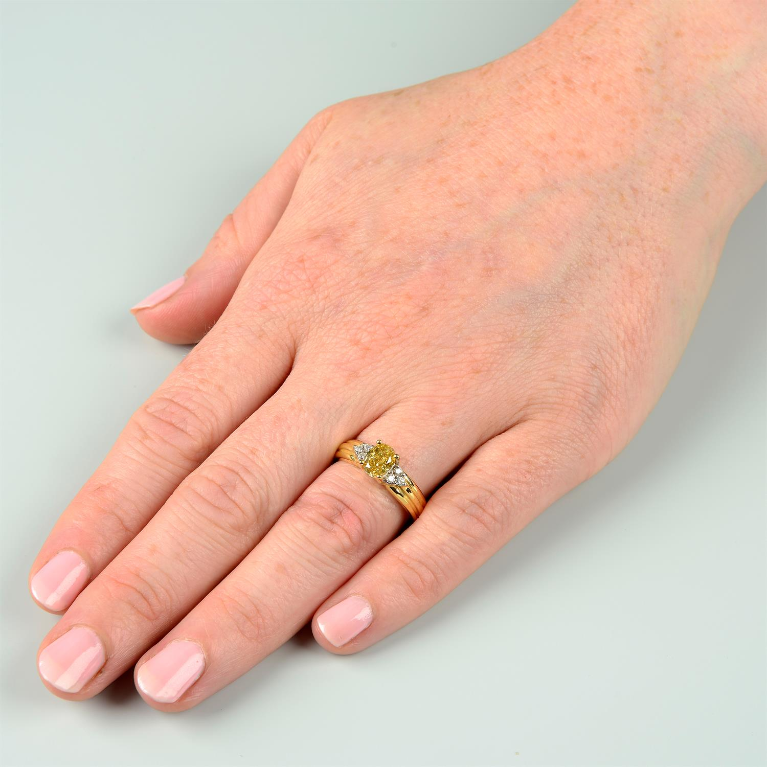 An 18ct gold oval-shape 'brownish-yellow' diamond ring, with brilliant-cut diamond trefoil sides. - Image 6 of 6