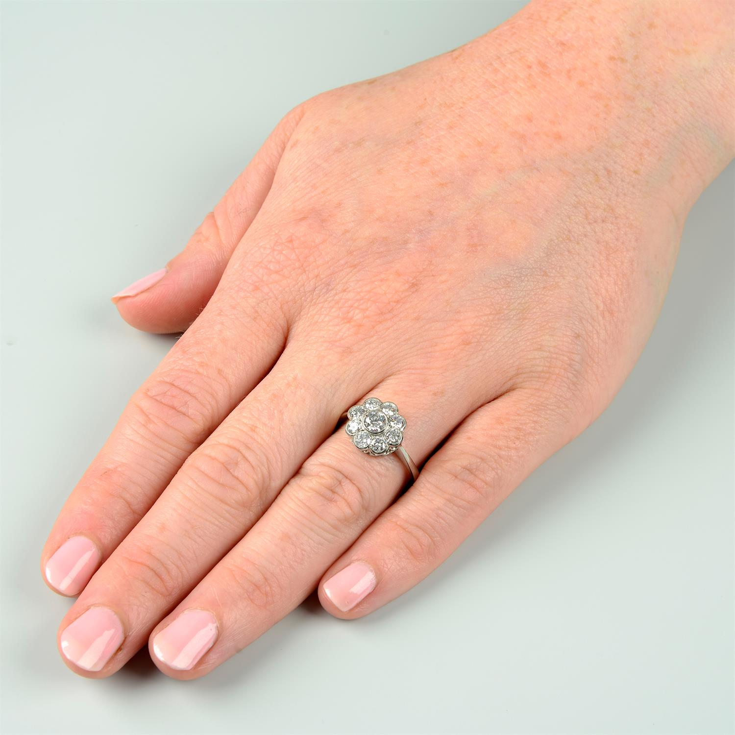 A brilliant-cut diamond floral cluster ring. - Image 6 of 6