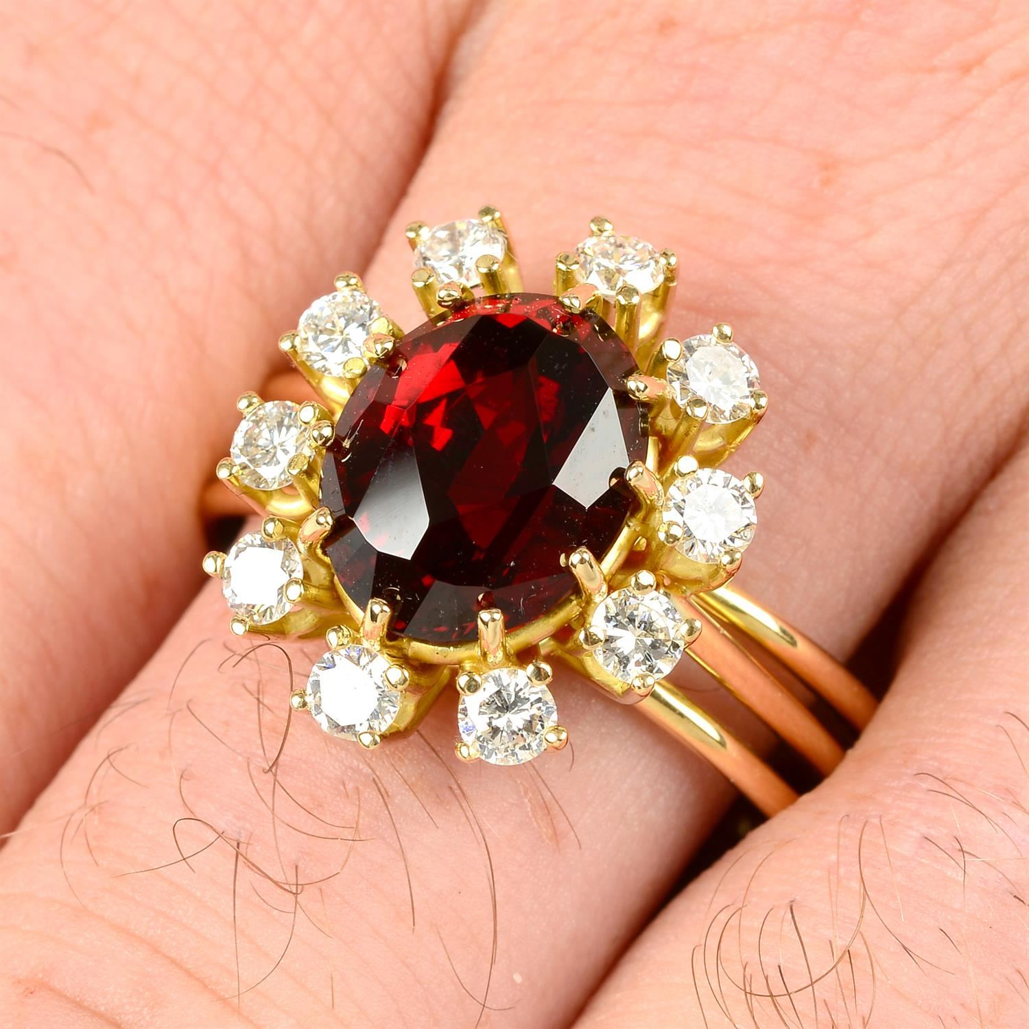 A garnet and brilliant-cut diamond cluster ring, attributed to Erwin Springbrunn.