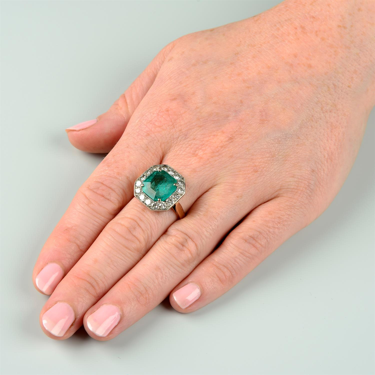A mid 20th century silver and gold, emerald and brilliant-cut diamond ring. - Image 6 of 6