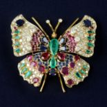 A diamond, emerald, ruby and sapphire butterfly brooch.