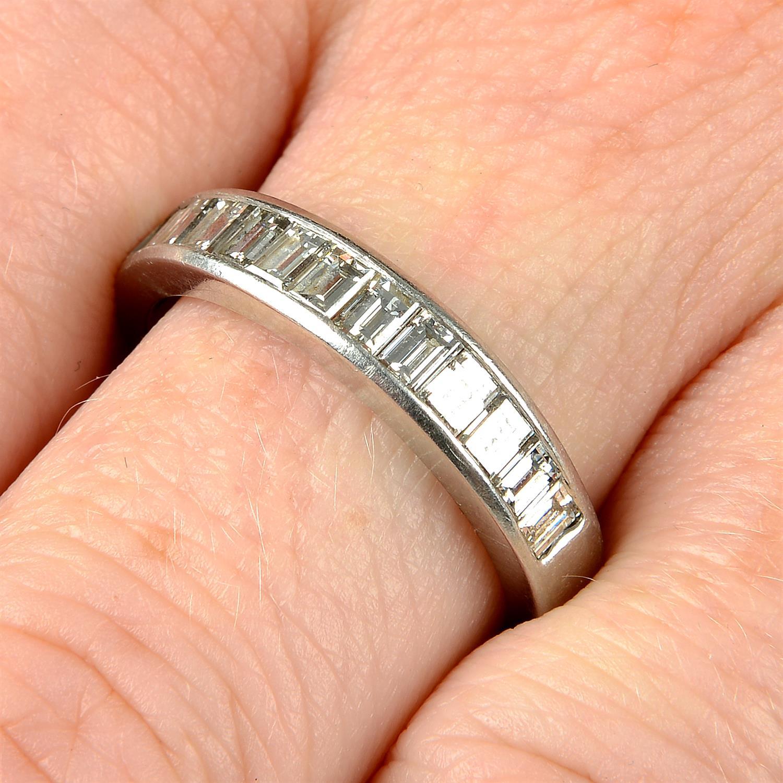 A platinum diamond half eternity ring, by Tiffany & Co.