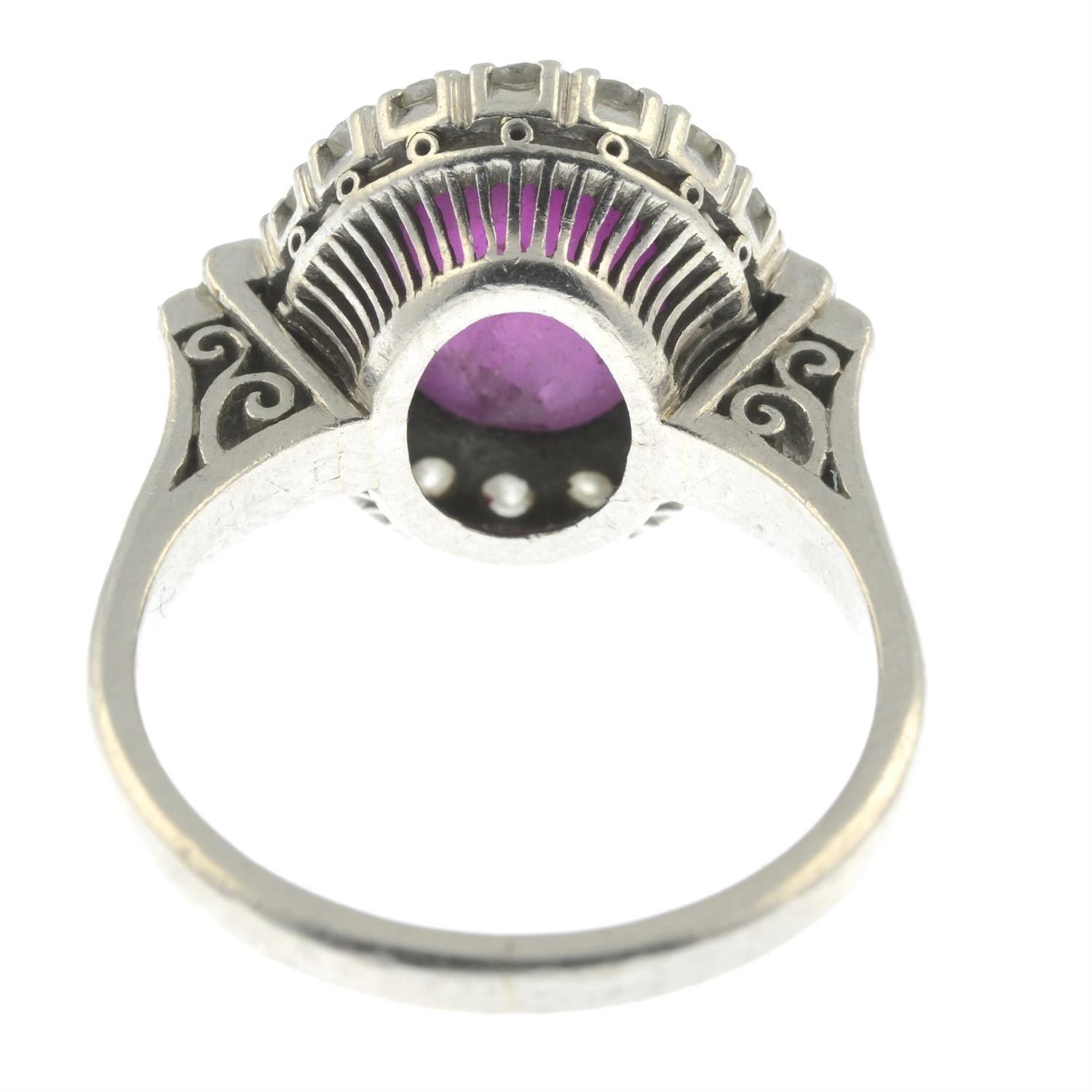 A ruby cabochon and vari-cut diamond cluster ring. - Image 4 of 6