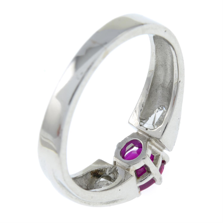 A Burma ruby and triangular-shape diamond three-stone ring. - Image 5 of 7