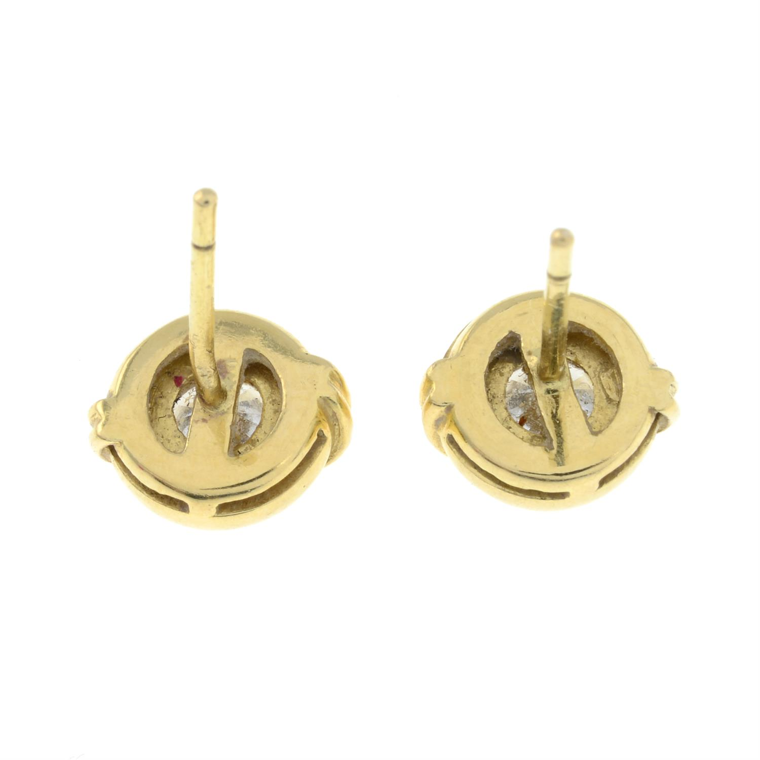 A pair of brilliant-cut diamond collet stud earrings, with raised double bar detail. - Image 3 of 4