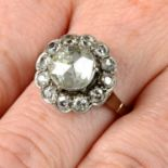 A rose and circular-cut diamond cluster ring.