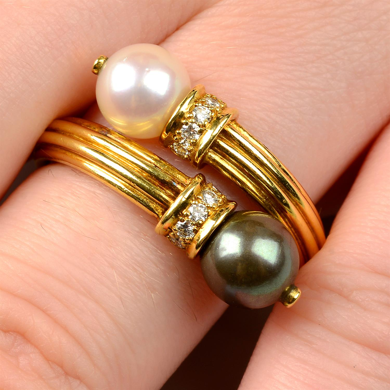 An 18ct gold grooved ring, with vari-hue cultured pearl and brilliant-cut diamond crossover