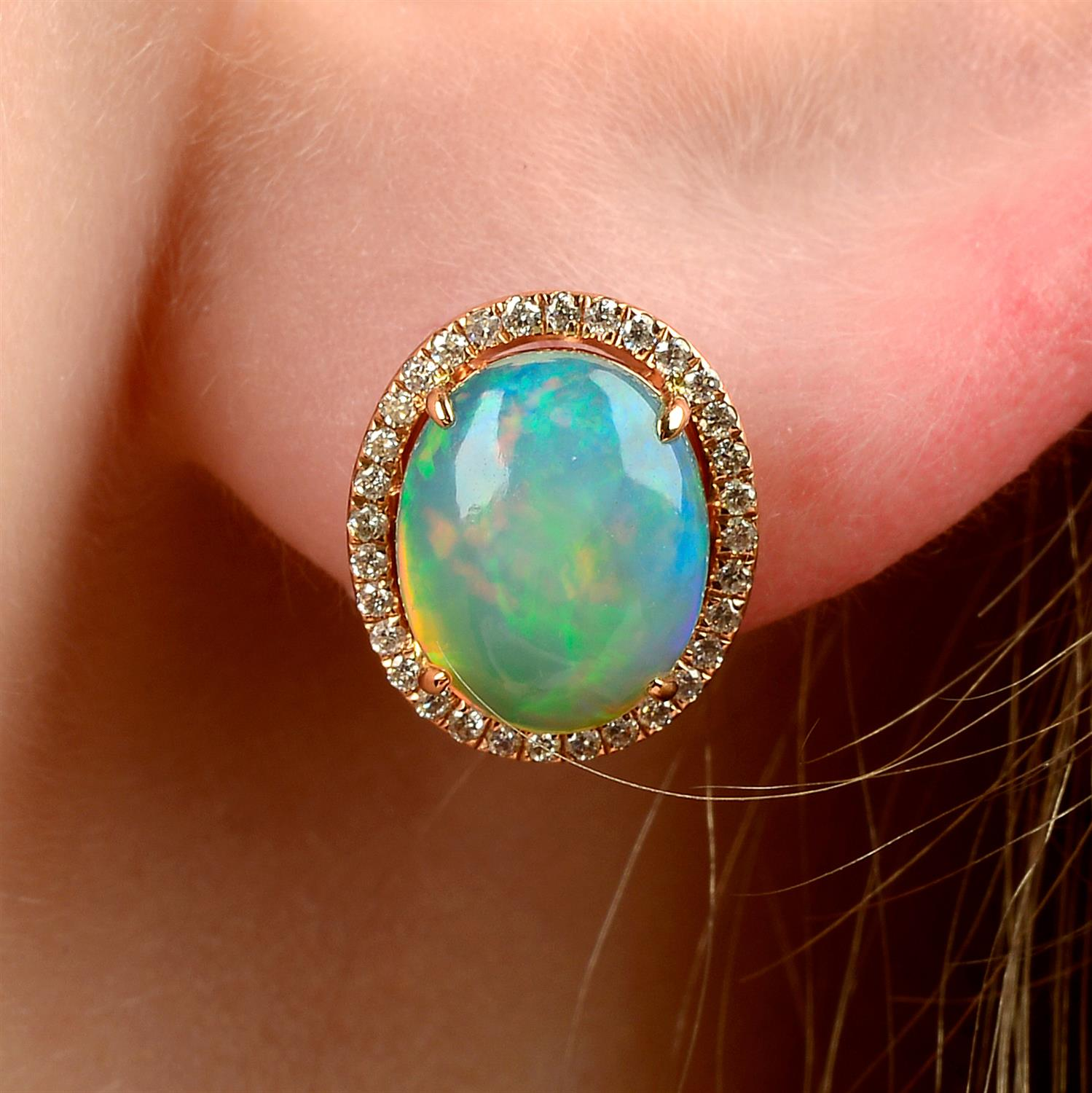 A pair of opal and brilliant-cut diamond cluster stud earrings.