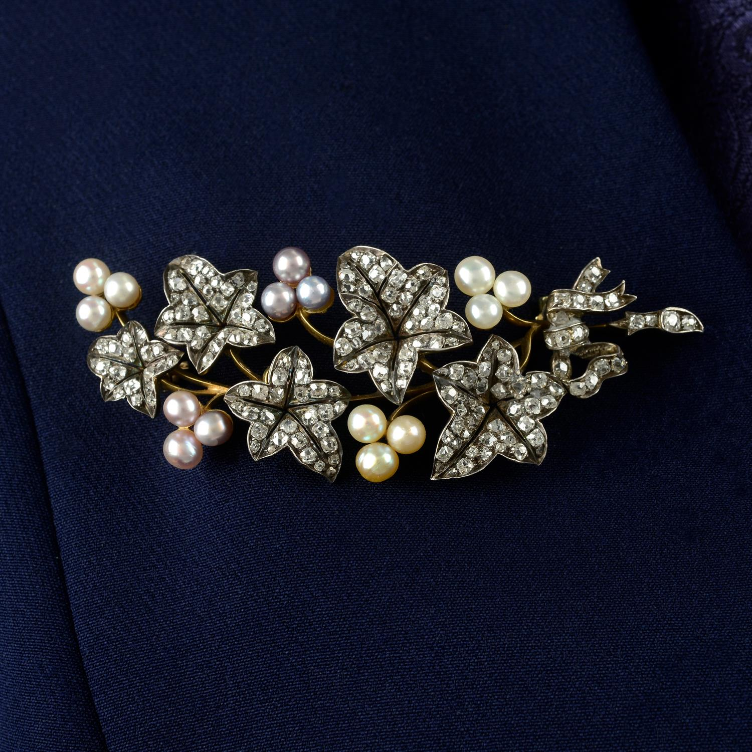 A late Victorian silver and gold, old-cut diamond and vari-hue pearl ivy sprig brooch.