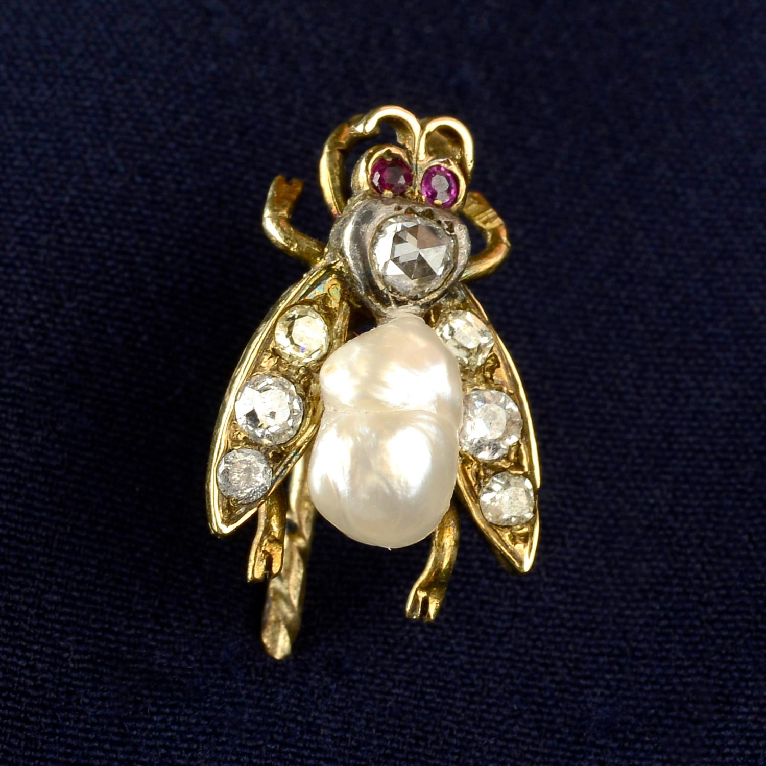 A late Victorian silver and gold, diamond, baroque pearl and ruby fly stickpin.