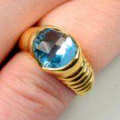 A blue topaz ring, by Bulgari.