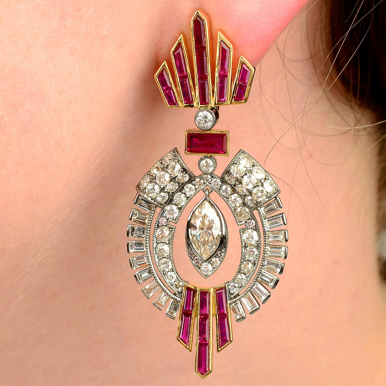 A pair of vari-cut diamond and calibré-cut ruby earrings, suspending a central marquise-shape