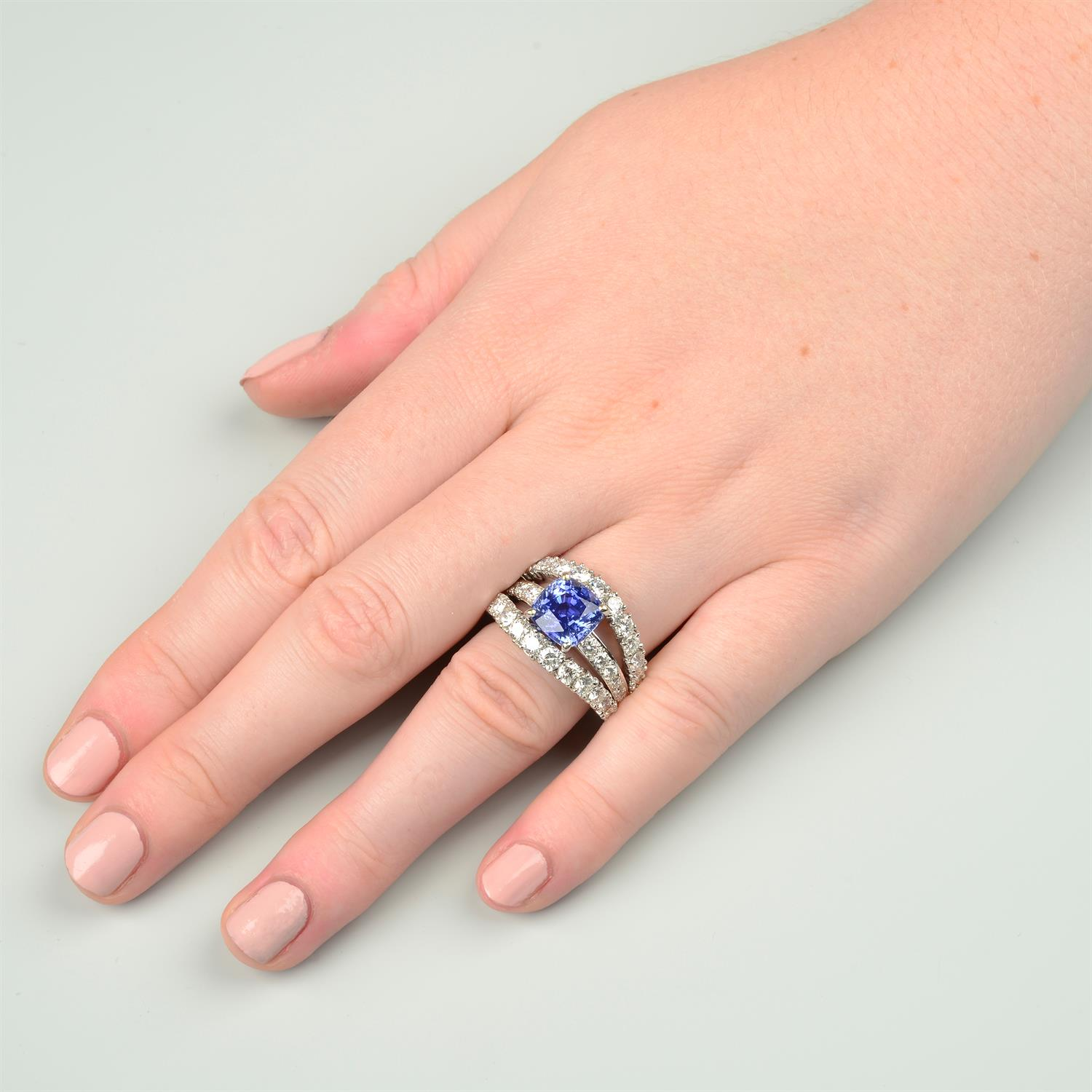 An 18ct gold no-heat sapphire and brilliant-cut diamond dress ring, by Ritz Fine Jewellery. - Image 8 of 8
