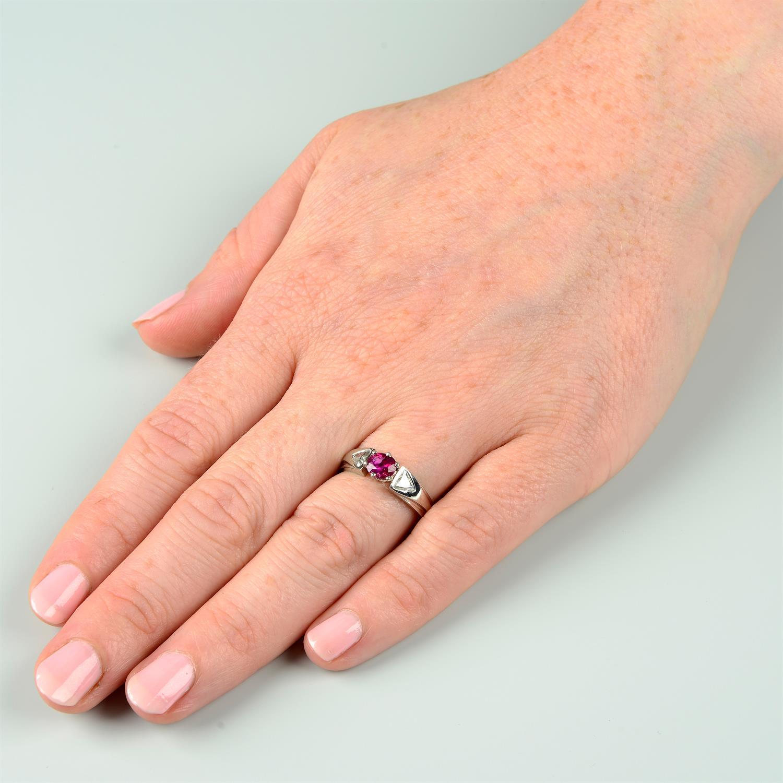 A Burma ruby and triangular-shape diamond three-stone ring. - Image 7 of 7