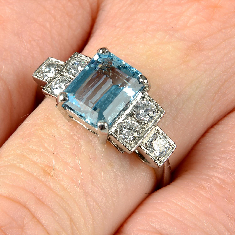 An aquamarine and brilliant-cut diamond dress ring.
