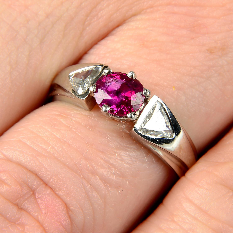 A Burma ruby and triangular-shape diamond three-stone ring.