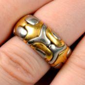 A bi-colour ring, by Bulgari.