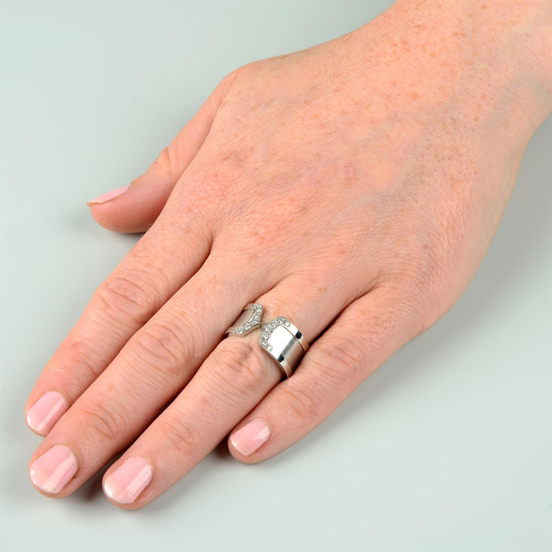 A diamond 'C de Cartier' ring, by Cartier. - Image 6 of 6