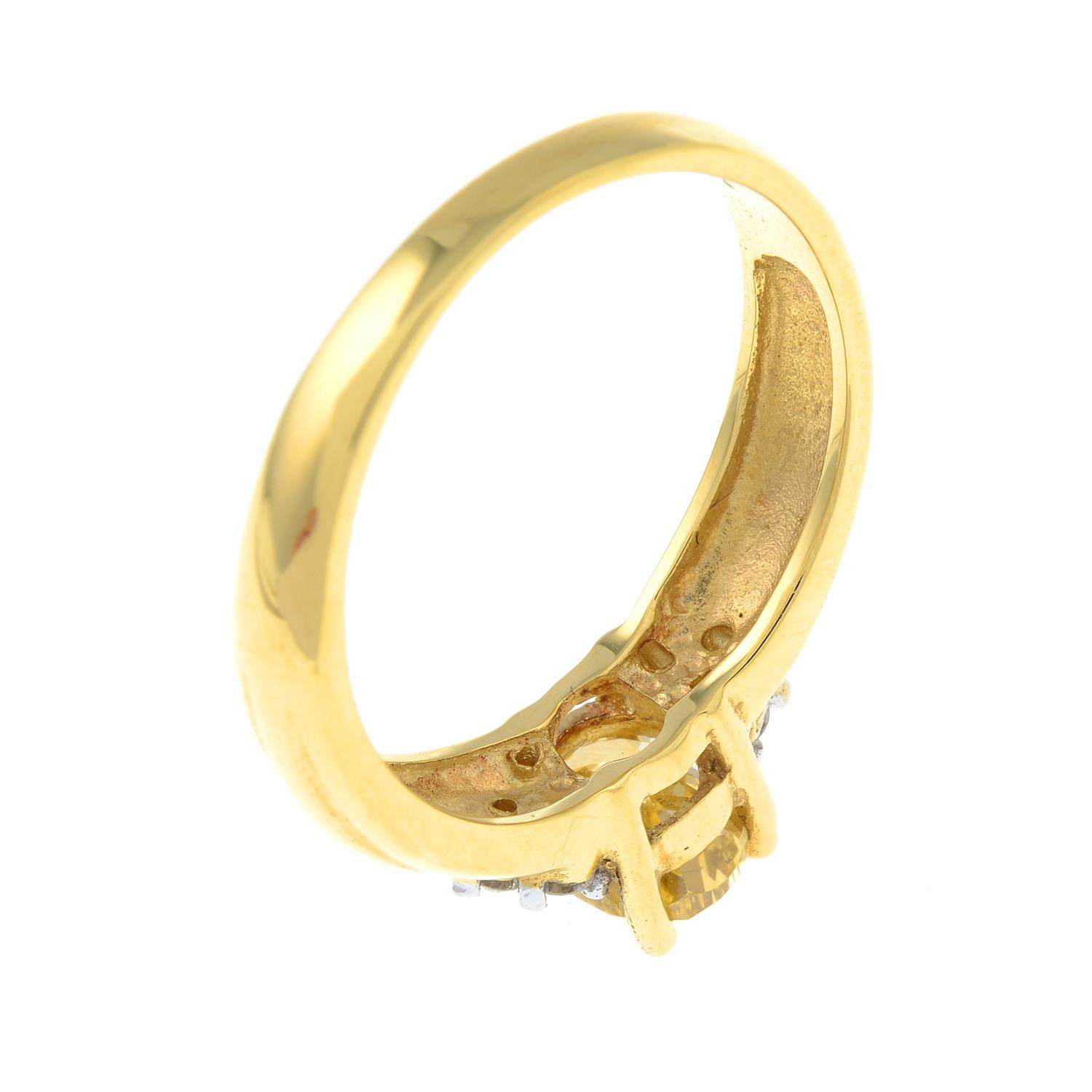 An 18ct gold oval-shape 'brownish-yellow' diamond ring, with brilliant-cut diamond trefoil sides. - Image 5 of 6