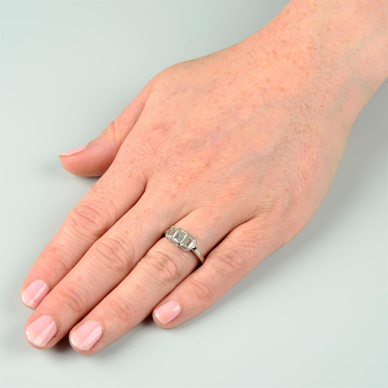 A rectangular-shape diamond three-stone ring. - Image 6 of 6