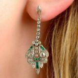 A pair of early 20th century platinum, emerald and diamond pierced lattice earrings.