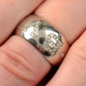 A pavé-set 'Monologo' ring, by Bulgari.