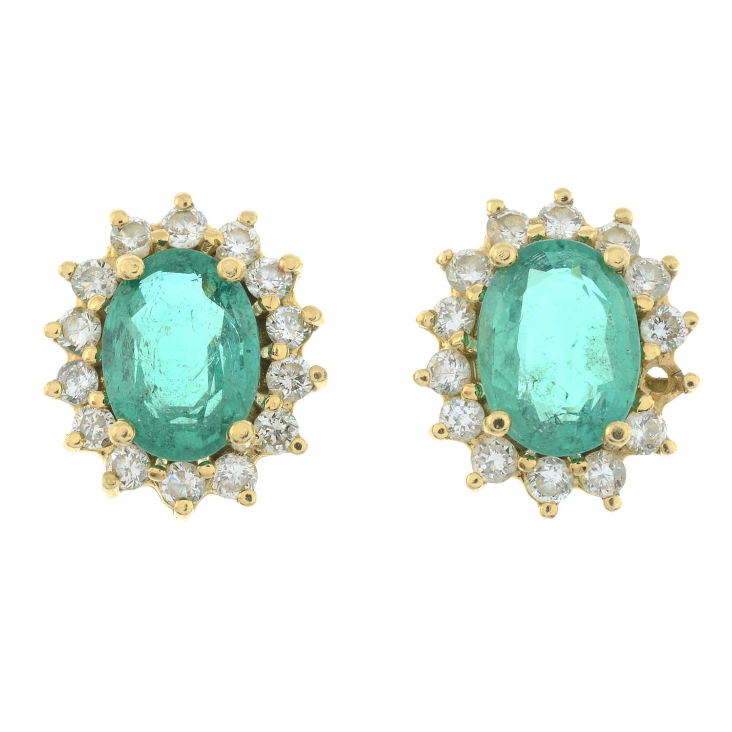 A pair of Zambian emerald and brilliant-cut diamond cluster earrings. - Image 2 of 5